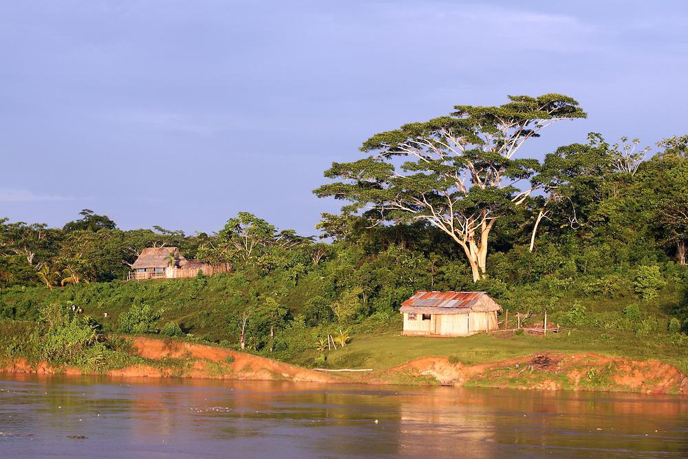 Idyllic riverfront scenery and rustic dwellings