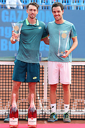 BUDAPEST, April 30, 2018  Italy's Marco Cecchinato (R) holds the trophy with runner-up John Millman of Australia during the awarding ceremony after winning the men's singles final at the Hungarian Open ATP tournament in Budapest, Hungary on April 29, 2018. Cecchinato won 2-0 and claimed the title. (Credit Image: © Attila Volgyi/Xinhua via ZUMA Wire)