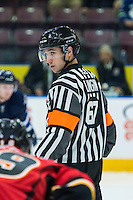 PENTICTON, CANADA - SEPTEMBER 16: Referee Mike Langin stands at the face off between # of Calgary Flames and the Winnipeg Jets on September 16, 2016 at the South Okanagan Event Centre in Penticton, British Columbia, Canada.  (Photo by Marissa Baecker/Shoot the Breeze)  *** Local Caption *** Mike Langin;