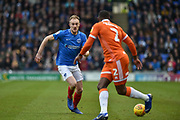 Portsmouth Defender, Matt Clarke (5)takes on Blackpool Defender, Donervon Daniels (2)during the EFL Sky Bet League 1 match between Portsmouth and Blackpool at Fratton Park, Portsmouth, England on 12 January 2019.
