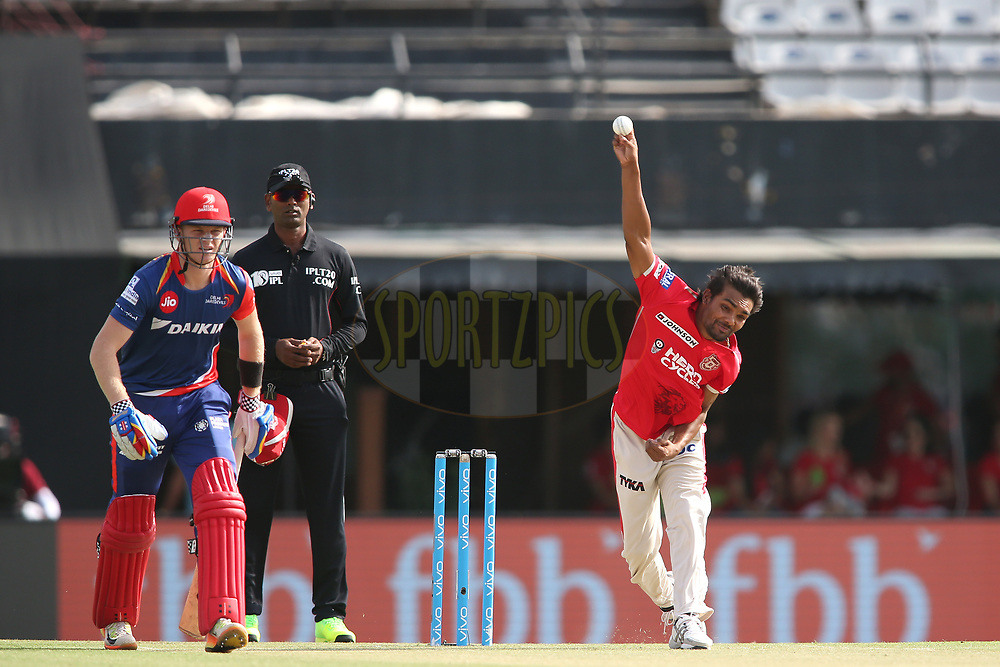 Sandeep Sharma of Kings XI Punjab sends down a delivery during match 36 of the Vivo 2017 Indian Premier League between the Kings XI Punjab and the Delhi Daredevils held at the Punjab Cricket Association IS Bindra Stadium in Mohali, India on the 30th April 2017<br /> <br /> Photo by Shaun Roy - Sportzpics - IPL