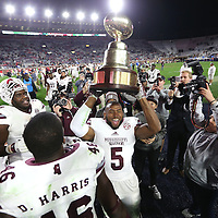 Adam Robison | BUY AT PHOTOS.DJOURNAL.COM<br /> Mississippi State players celebrate with the Egg Bowl trophy after beating Ole Miss 55 to 20.