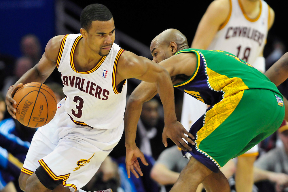 March 6, 2011; Cleveland, OH, USA; Cleveland Cavaliers point guard Ramon Sessions (3) drives around New Orleans Hornets point guard Jarrett Jack (2) during the fourth quarter at Quicken Loans Arena. The Hornets beat the Cavaliers 96-81. Mandatory Credit: Jason Miller-US PRESSWIRE