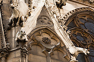 Gargoyles look down from the exterior of Paris' Cathedral of Notre Dame.