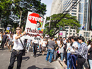 29 NOVEMBER 2013 - BANGKOK, THAILAND: Anti-government protestors march down Witthayu Road (also called Wireless Road) towards the US Embassy. Several thousand Thai anti-government protestors marched on the US Embassy in Bangkok. They blew whistles and asked the US to honor their efforts to unseat the elected government of Yingluck Shinawatra. The anti-government protestors marched through several parts of Bangkok Friday paralyzing traffic but no clashes were reported, even after a group protestors tried to occupy Army headquarters.       PHOTO BY JACK KURTZ