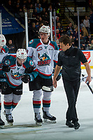 KELOWNA, CANADA - DECEMBER 30: Liam Kindree #26 is assisted off the ice by Nolan Foote #29 of the Kelowna Rockets with athletic therapist Scott Hoyer against the Victoria Royals on December 30, 2017 at Prospera Place in Kelowna, British Columbia, Canada.  (Photo by Marissa Baecker/Shoot the Breeze)  *** Local Caption ***