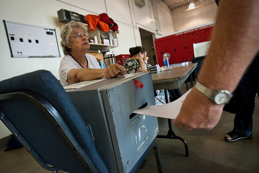 Carla Skinner of Post Falls directs a voter to place his vote into the secure ballot box at the Kootenai County Fire and Rescue Station #3 in Post Falls on Tuesday. Voting at the polls will float a $2 million bond to Kootenai County patrons to pay for completing a training facility and remodeling the administration building along Seltice Avenue between Post Falls and Coeur d'Alene.