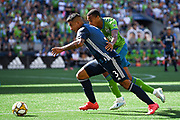 Diego Polenta (3) of LA Galaxy moves the ball past Saad Abdul-Salaam (12) of Seattle Sounders during the MLS soccer match on Saturday, September 1, 2019, in Seattle, Washington. (Alika Jenner/Image of Sport via AP)