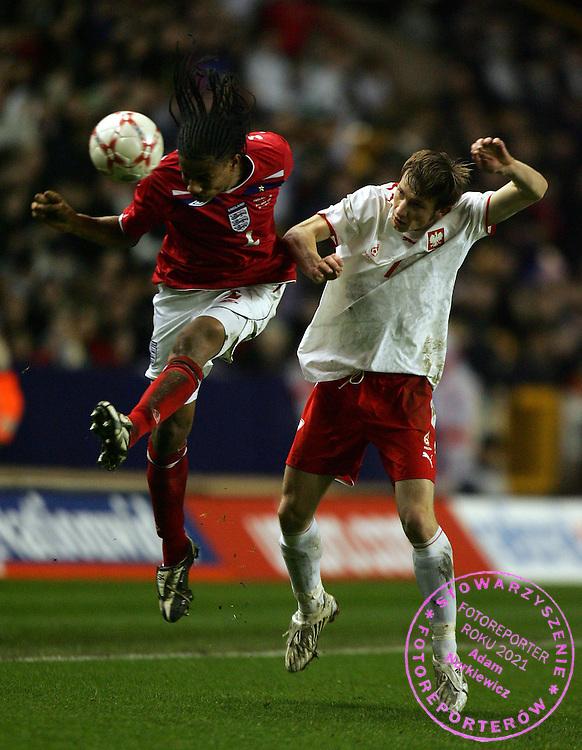 Michael Mancienne of England U21 battles with Szymon Pawlowski of Poland U21