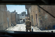 Iraqi soldiers in the Old City of Mosul search for remaining ISIS fighters.
