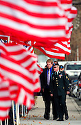 Flags line the sidewalk outside a LDS stake center as people attend the funeral of U.S. Army Pfc. Aaron Nemelka, Saturday,  Nov. 14, 2009 in West Jordan, Utah. Nemelka was one of 13 gunned down at Fort Hood, Texas. (AP Photo/Colin Braley)