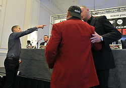 A security officer ushers away boxing promoter David Higgins (left) and an unidentified colleague (centre) after they interrupted the pre-fight press conference for the WBO heavyweight title challenge fight against champion Joseph Parker and Hughie Fury in Manchester on Saturday, at the Landmark Hotel, London.