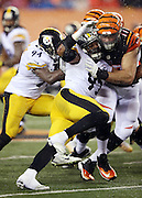 Pittsburgh Steelers inside linebacker Lawrence Timmons (94) gets blocked by Cincinnati Bengals tackle Andrew Whitworth (77) as he rushes the quarterback during the NFL AFC Wild Card playoff football game against the Cincinnati Bengals on Saturday, Jan. 9, 2016 in Cincinnati. The Steelers won the game 18-16. (©Paul Anthony Spinelli)