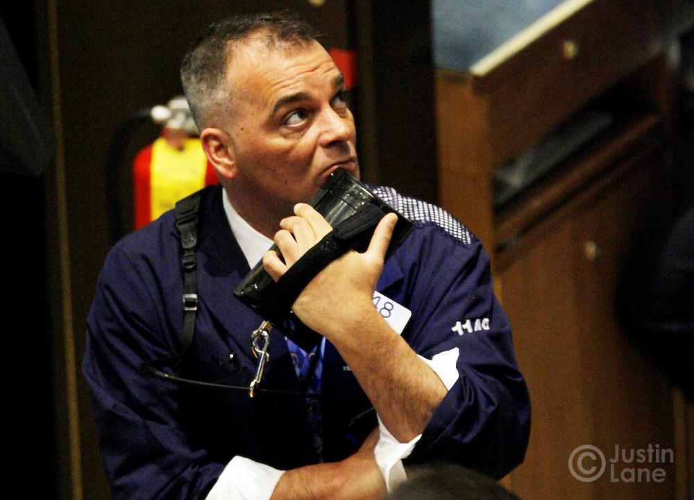 A trader works on the floor of the New York Stock Exchange at the start of trading in New York, New York on Wednesday 28 February 2007. The Dow Jones Industrial average ended down 416 points yesterday, but stocks showed some signs of rebounding on Wednesday.