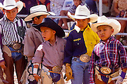 08 SEPTEMBER 2000 -- WINDOW ROCK, AZ: Boys wait to compete in sheep riding (mutton busting) at the Navajo Nation Fair in Window Rock, AZ. The Navajo Nation Fair is the largest native American gathering in the US. Photo by Jack Kurtz