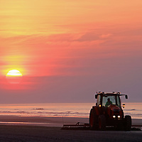 Beach cleaning at dawn, Wildwood Crest, New Jersey, USA
