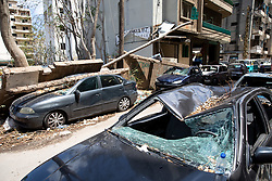 © Licensed to London News Pictures. 10/08/2020. Beirut, Lebanon. Smashed cars under debris in a backstreet in Mar Mikhael, central Beirut, as part of the aftermath around Beirut city centre following an explosion in Beirut port on Tuesday 4 August. Mar Mikhael and Gemmayzeh were two of the worst affected areas. Photo credit : Tom Nicholson/LNP