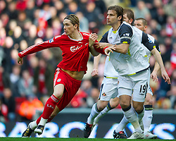 LIVERPOOL, ENGLAND - Sunday, March 28, 2010: Liverpool's Fernando Torres has his shirt pulled by Sunderland's Lorik Cana during the Premiership match at Anfield. (Photo by: David Rawcliffe/Propaganda)