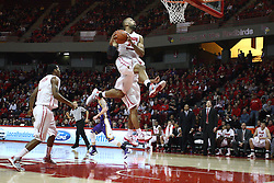 05 January 2013:  Jackie Carmichael makes a Jodanesque approach for a slam dunk during an NCAA Missouri Valley Conference (MVC) mens basketball game between the Northern Iowa Panthers and the Illinois State Redbirds in Redbird Arena, Normal IL