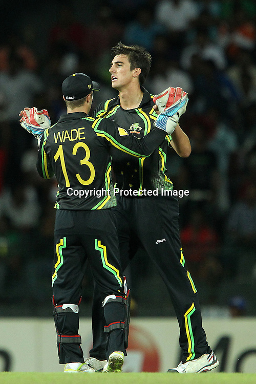 Patrick Cummins and Matthew Wade celebrate the wicket of Gautam Gambhir during the ICC World Twenty20 Super 8s match between Australia and India held at the Premadasa Stadium in Colombo, Sri Lanka on the 28th September 2012<br /> <br /> Photo by Ron Gaunt/SPORTZPICS