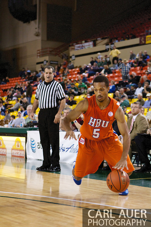 November 25th, 2010:  Anchorage, Alaska - Houston Baptist guard, Miles Dixon (5) drives baseline in the Huskies 55-73 loss to Arizona State in a first round game of the Great Alaska Shootout.