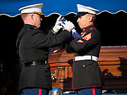 22 NOVEMBER 2019 - DES MOINES, IOWA:  U.S. Marine Corps Maj. JOHN SHECKELLS, left, and a member of the Marine Corps Honor Guard fold the US flag during the reinterment service of US Marine Reserve Corps Private Channing Whitaker. Whitaker died in the Battle of Tarawa on Nov. 22, 1943. He was buried on Betio Island, in the Gilbert Islands, and his remains were recovered in March 2019. He was identified by a DNA match with surviving family members in Iowa. Whitaker was reintered in the Glendale Cemetery in Des Moines exactly 76 years after his death in World War Two. About 1,000 US Marines and sailers were killed in four days during the Battle of Tarawa.            PHOTO BY JACK KURTZ