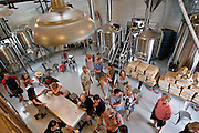 Beer enthusiasts enjoy samples at Bang Brewing Company in St. Paul, Saturday, May 31, 2014. [ BEN BREWER • Special to the Star Tribune _ Assignments #  20034753A  DATE: May 31, 2014 SLUG: greenline.vita EXTRA INFORMATION: