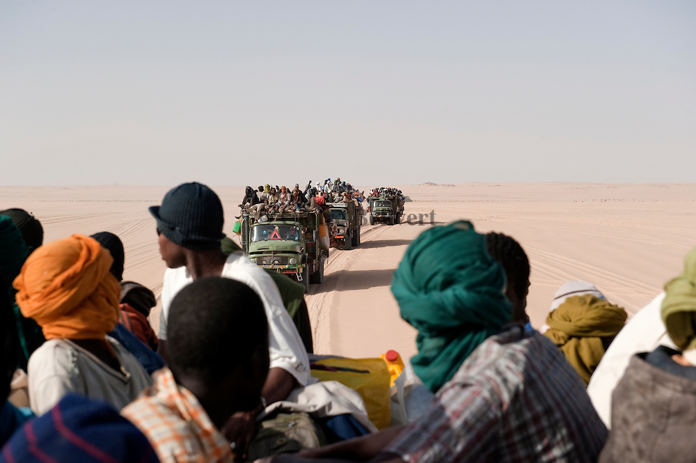 African migrants on trucks in the Ténéré desert. They are rapatrieted from Libya by IOM ( Internation Organization for Migration ) to Agadez, Niger.