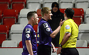 Morecambe players argue the penalty decision during the Sky Bet League 2 match between Cheltenham Town and Morecambe at Whaddon Road, Cheltenham, England on 16 January 2015. Photo by Alan Franklin.