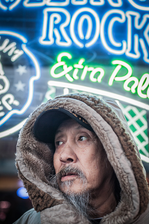 "Retired commercial fisherman, Raymond Trigg in front of the Panhandle Bar on Fourth Avenue in downtown Anchorage.  Mr Trigg was born in Nome but grew up in Seward where he lives in the summer.  ""I come to Anchorage each winter to play"".  ℅ Panhanle Bar, 312 W. 4th Ave. 99501"