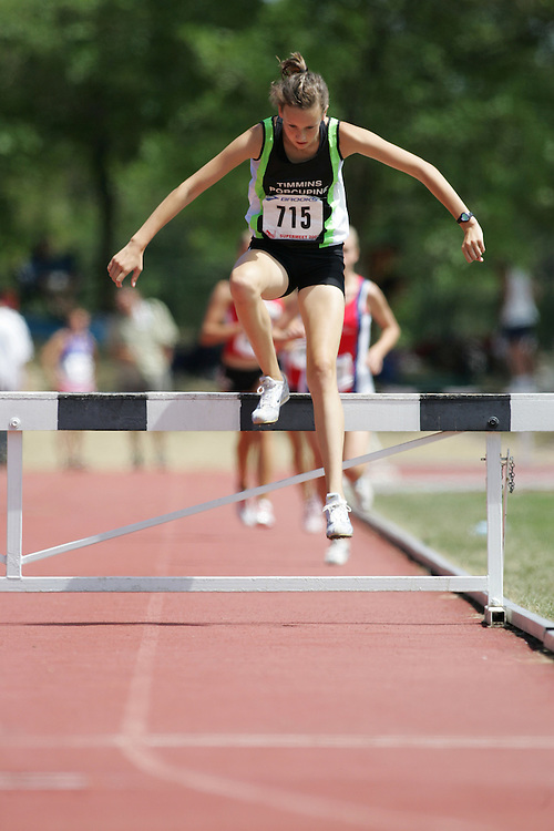 Britney Alland competing in the steeple chase at the 2007 OTFA Supermeet II. The Ontario Track and Field Association Bantam-Midget-Juvenile Championships were held in Toronto from August 3rd to 5th.