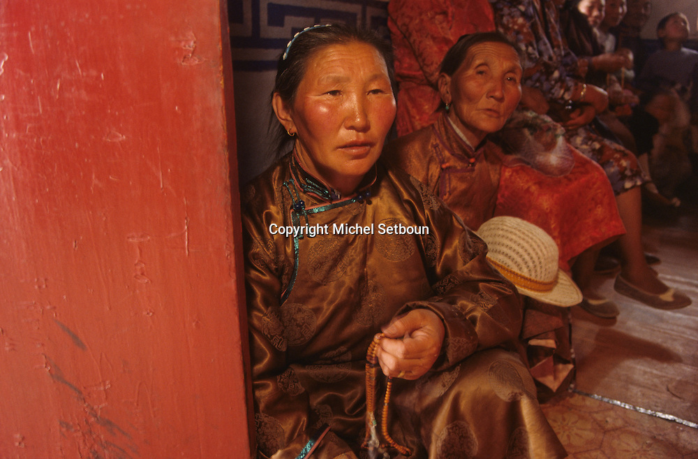 Mongolia. woman praying  in Shankin Barun Kuree new monastery inHurjit area
