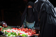 Veiled Berber women at the market in Rissani, Morocco.