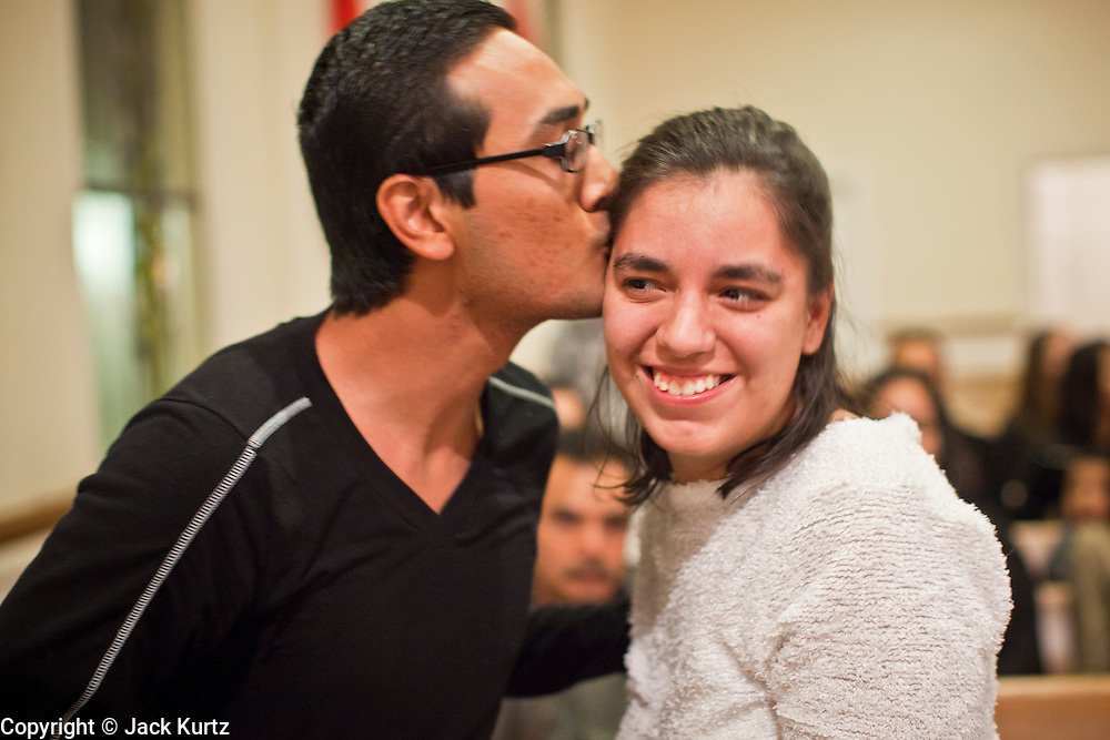 19 DECEMBER 2010 - PHOENIX, AZ: DANIEL RODRIGUEZ kisses ESPERANZA PORCHINI at a prayer service in support of the DREAM Act in Phoenix. Rodriguez participated in a hunger strike at the offices of US Sen. John McCain in support of the Act. McCain, who several years ago supported the DREAM Act, voted against it Saturday. About 100 supporters of the DREAM Act gathered at First Congregational Church of Christ in Phoenix Sunday night, December 19, for a prayer vigil in support of the DREAM Act, which was defeated in the US Senate Saturday, Dec. 18. The DREAM Act, was supported by the Obama administration, and was an important part of the administration's immigration reform platform. The defeat of the DREAM Act, which would have established a path to citizenship for undocumented immigrants who were brought to the US by their parents when they were children, set back the President's immigration reform efforts.    PHOTO BY JACK KURTZ