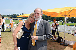VISCOUNT & VISCOUNTESS COWDRAY at the Veuve Clicquot Gold Cup, Cowdray Park, Midhurst, West Sussex on 21st July 2013.