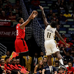 Oct 11, 2018; New Orleans, LA, USA; Toronto Raptors guard Jordan Loyd (8) shoots over New Orleans Pelicans guard Jrue Holiday (11) during the first half at the Smoothie King Center. Mandatory Credit: Derick E. Hingle-USA TODAY Sports