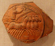Terracotta medallion (Rhône valley ware), Roman, Mid-Imperial. late 2nd–early 3rd century A.D. The medallion depicts a charioteer in his quadriga, holding the victor's crown and palm branch.