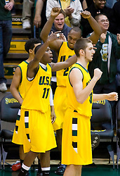 January 30, 2010; San Francisco, CA, USA;  San Francisco Dons guard Dontae Bryant (11) celebrates on the bench in overtime against the Gonzaga Bulldogs  at the War Memorial Gym.  San Francisco defeated Gonzaga 81-77 in overtime.