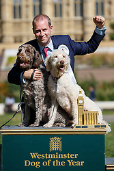 © Licensed to London News Pictures. 08/09/2016. London, UK. JONATHAN REYNOLDS MP (C) wins the Westminster Dog of the Year competition with his dogs 'Clinton' and 'Kennedy' in Victoria Tower Gardens, London on Thursday, 8 September 2016. Photo credit: Tolga Akmen/LNP