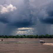 The Marmore river border crossing seen from the Brazilian side while a tropical storm is approaching. In the background, Bolivia