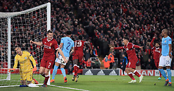 Manchester City goalkeeper Ederson (left) appears dejected as Liverpool's Sadio Mane (centre) celebrates scoring his side's third goal of the game during the UEFA Champions League quarter final, first leg match at Anfield, Liverpool.