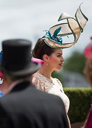 © Licensed to London News Pictures. 19/06/2018. London, UK.  Racegoers with elaborate hats attend day one of Royal Ascot at Ascot racecourse in Berkshire, on June 19, 2018. The 5 day showcase event, which is one of the highlights of the racing calendar, has been held at the famous Berkshire course since 1711 and tradition is a hallmark of the meeting. Top hats and tails remain compulsory in parts of the course. Photo credit: Ben Cawthra/LNP