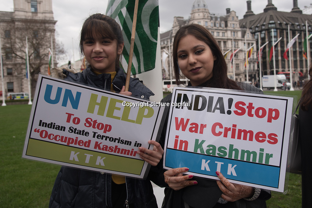 Kashmiri girls, women and children raped and murder by Indian army and Atrocities on Kashmiris. Protestors demand their right to self-determination and Indian war crimes against Kashmir, and the presence of Indian Prime Minister Narendra Modi's visit to the UK for the Commonwealth Heads of Government Meeting this week.