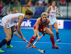 England's Georgie Twigg watches Carlien Dirkse van den Heuvel of The Netherlands. England v The Netherlands - Final Unibet EuroHockey Championships, Lee Valley Hockey & Tennis Centre, London, UK on 30 August 2015. Photo: Simon Parker