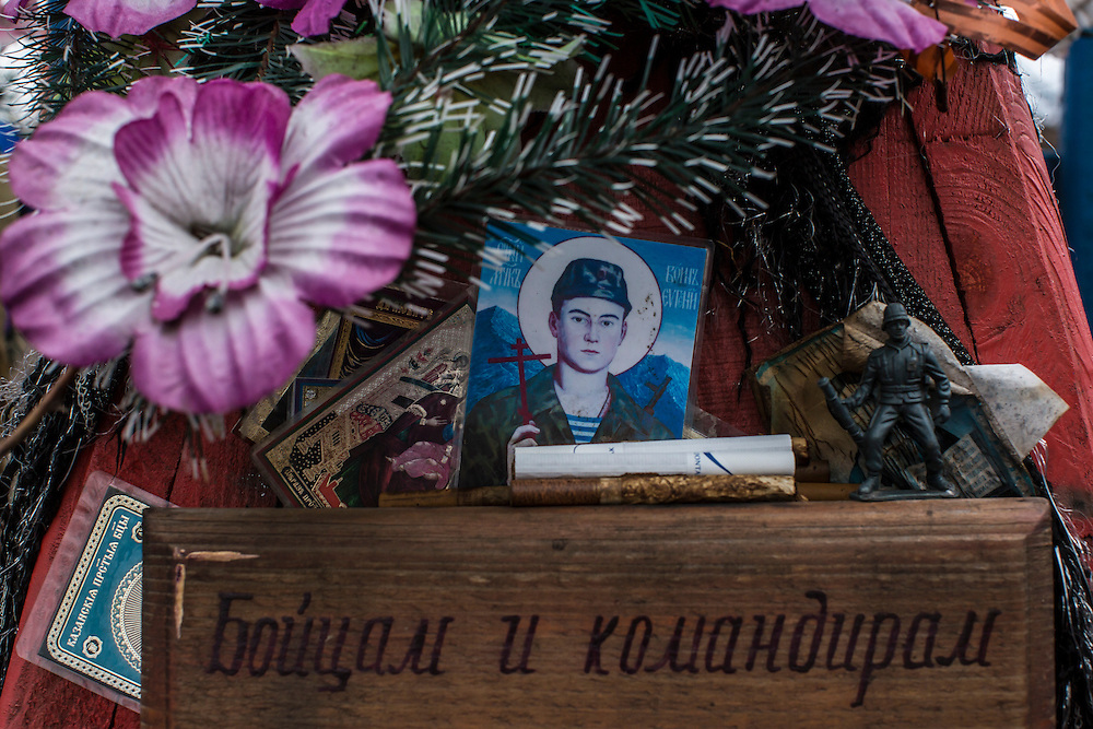 A picture of a soldier in the style of a religious icon decorates a war memorial to fighters killed both in World War II as well as the more recent conflict in eastern Ukraine on Sunday, March 27, 2016 in Nikishyne, Ukraine.