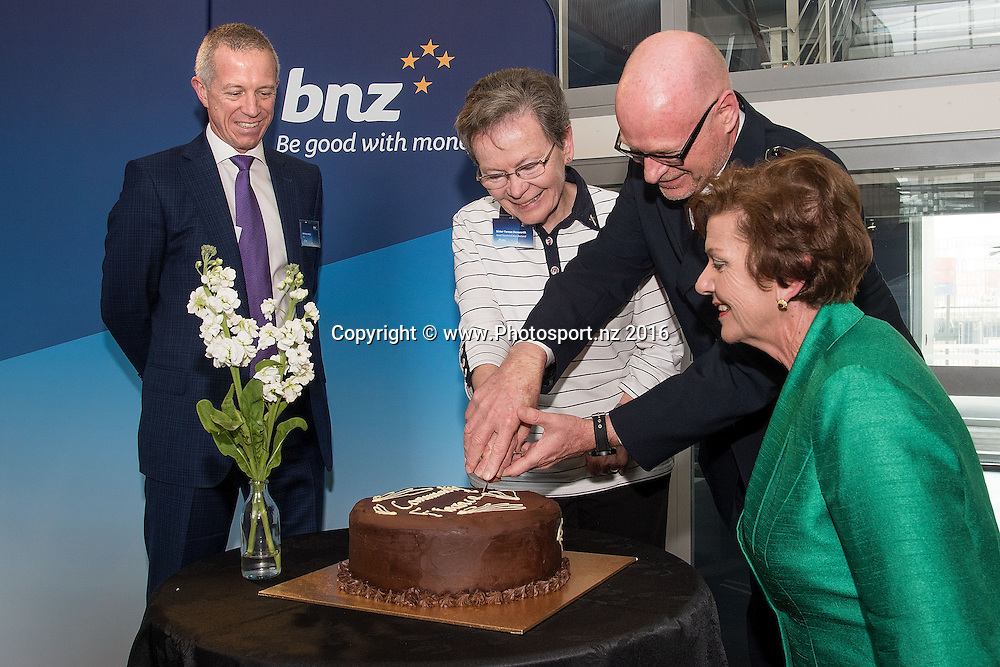 Anthony Healy BNZ CEO (L) with Sister Teresa Donworth of Good shepherd NZ (Centre L),   Salvation Army's Commander Robert Donaldson (Centre R) and Minister Anne Tolley (R cut a cake during the BNZ Community Finance Initiative Announcement at the BNZ building in Wellington on Wednesday the 12th of October 2016. Copyright Photo by Marty Melville / www.Photosport.nz