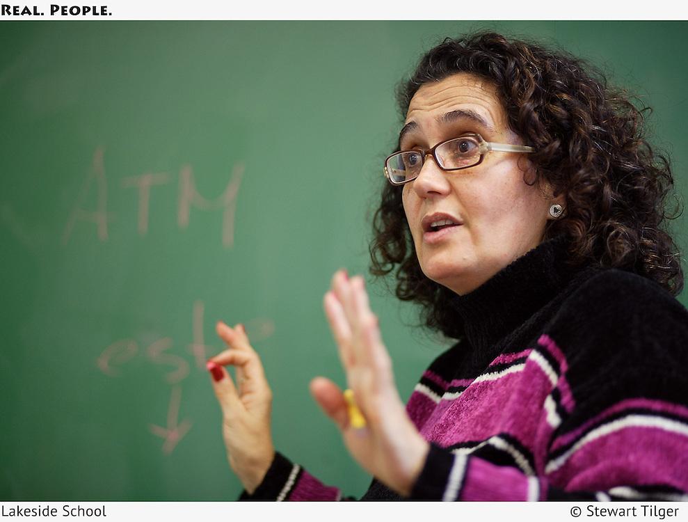 Language teacher instructing her class.