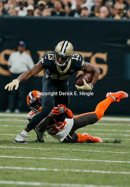 Sep 16, 2018; New Orleans, LA, USA; New Orleans Saints wide receiver Michael Thomas (13) breaks a tackles by Cleveland Browns cornerback Terrance Mitchell (39) during the first quarter of a game at the Mercedes-Benz Superdome. Mandatory Credit: Derick E. Hingle-USA TODAY Sports