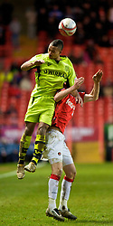 LONDON, ENGLAND - Saturday, January 30, 2010: Charlton Athletic's David Mooney is climbed all over by Tranmere Rovers' Shaleum Logan during the Football League One match at the Valley. (Photo by Gareth Davies/Propaganda)