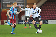Dan Gardner (25) of Bury crosses ball  during the Sky Bet League 1 match between Scunthorpe United and Bury at Glanford Park, Scunthorpe, England on 19 April 2016. Photo by Ian Lyall.